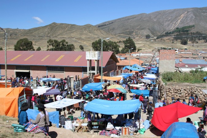 The crowded streets are abuzz with buying and selling, Tarabuco, Bolivia