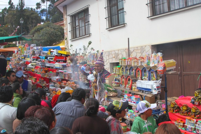 People crowd in to get their miniatures blessed, La Fiesta de las Alasitas, Bolivia
