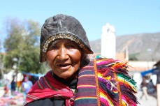 A campesino woman poses for a photo in Tarabuco, Sucre, Bolivia
