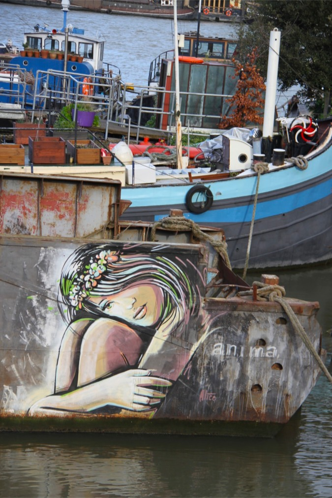 Street art on a boat on the River Thames, Rotherhithe, London, England