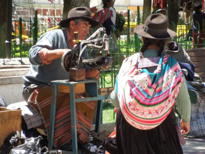 Street vendor repairing shoes, Tarabuco, Bolivia