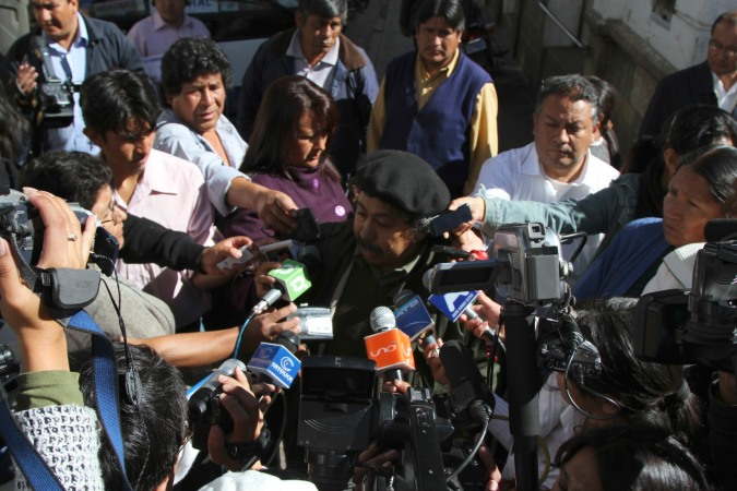Media crowd around a strike organiser, Sucre, Bolivia