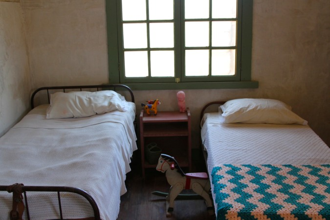 Bedroom in cottage, Humberstone, Atacama Desert, Chile