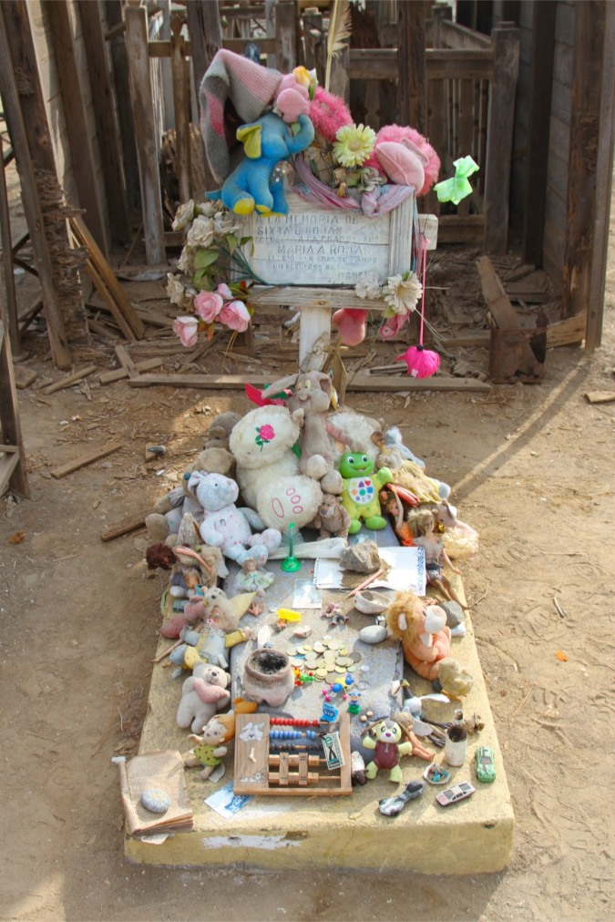 Child's grave in a cemetery overlooking the Pacific Ocean, northern Chile
