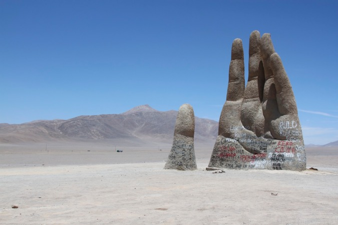 The Mano del Desierto by Chilean sculptor Mario Irarrázabal in the Atacama Desert, Chile