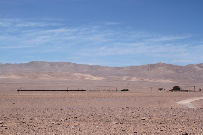 A train passing through the Atacama Desert near to Tocopilla, Chile