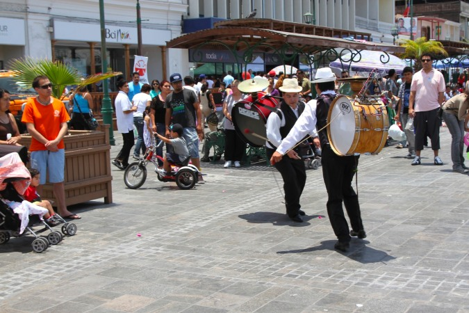 Musicians entertain the crowds in the Plaza de Armas, Iquique, Chile