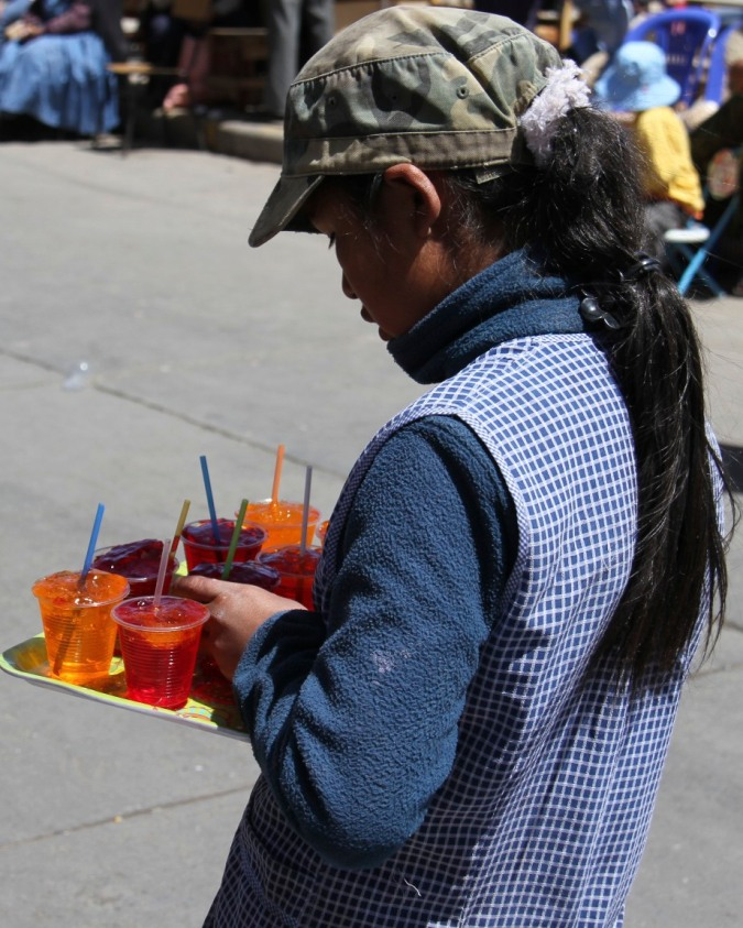 A young girl selling jellies, Potosi, Bolivia