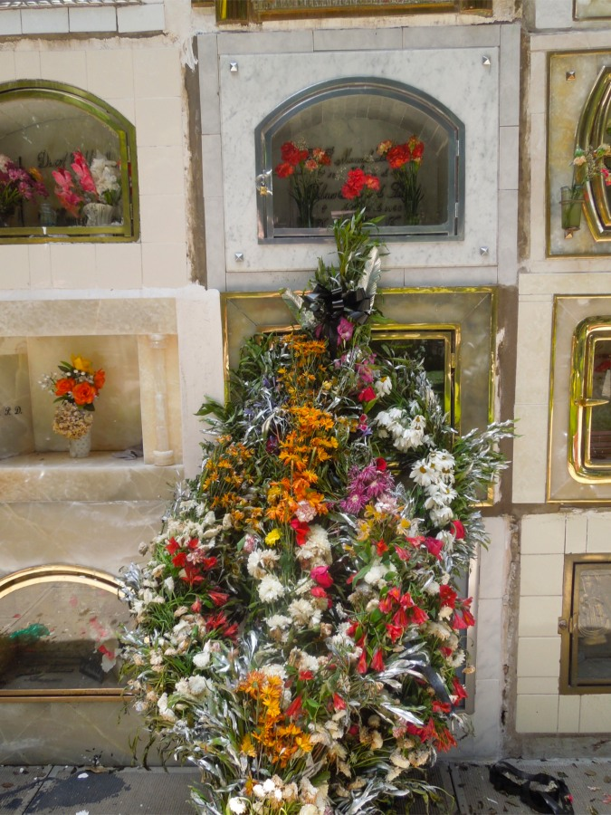 Flowers and graves in Sucre's cemetery, Bolivia