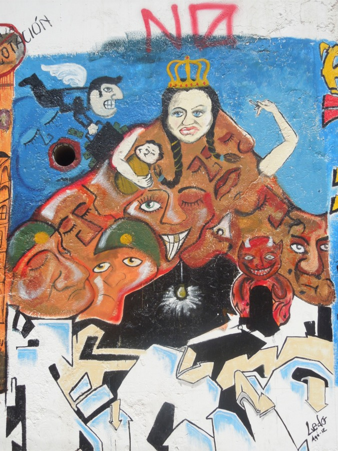 Political street art mimicking the famous painting of Potosi's Cerro Rico, Sucre, Bolivia