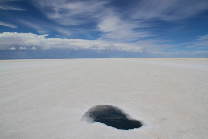 Large hole in the Salar de Uyuni, Bolivia