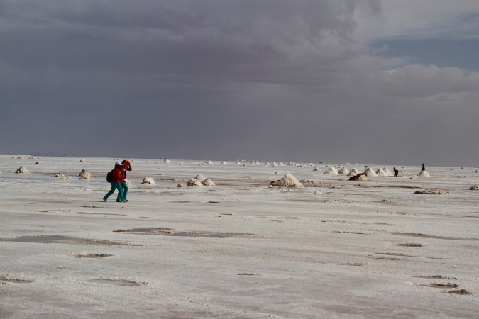 Children walk through a salt mining area, Salar de Uyuni, Bolivia