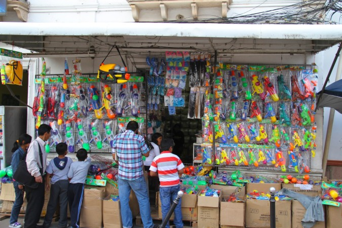 Stall selling water guns for Carneval, Sucre, Bolivia