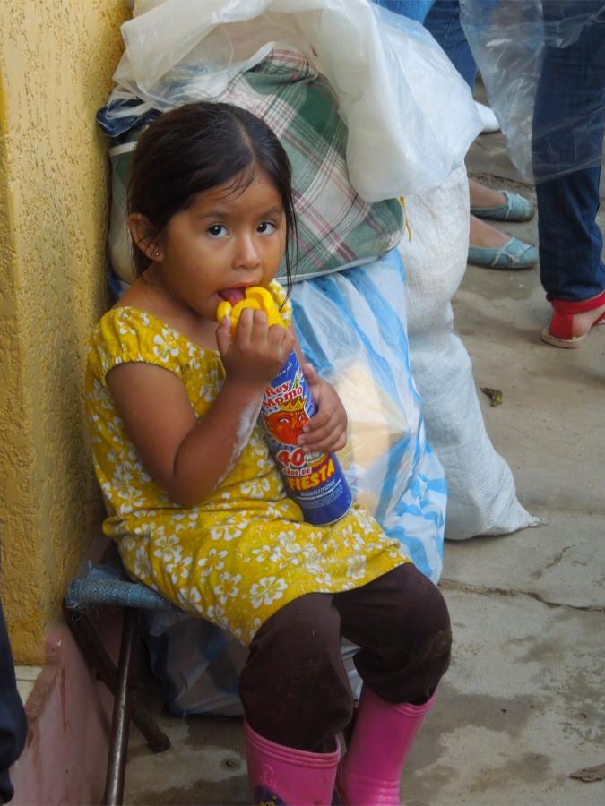 Child with foam, Carneval in San Lorenzo, Tarija, Bolivia