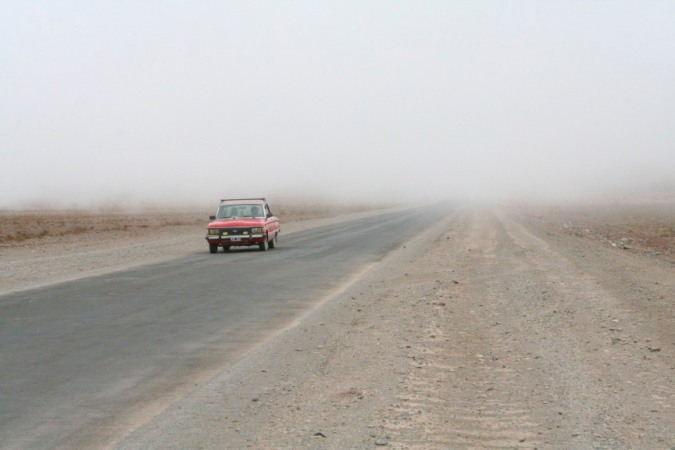 Car emerging from the mist en route to Cachi, Salta, Argentina