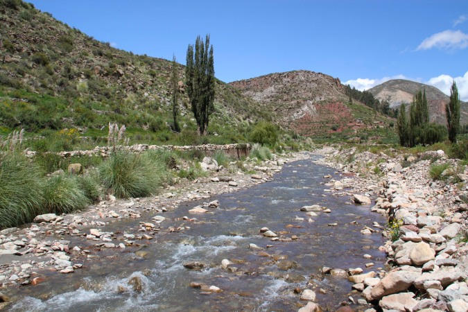 Walking alongside a river to the waterfall, Cayara, Potosi, Bolivia