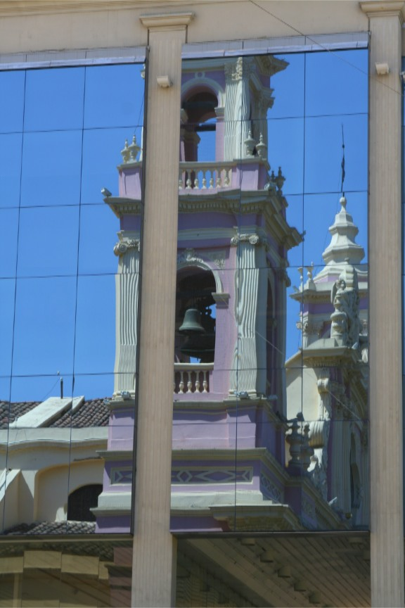 Salta's Cathedral reflected in a glass building, Argentina