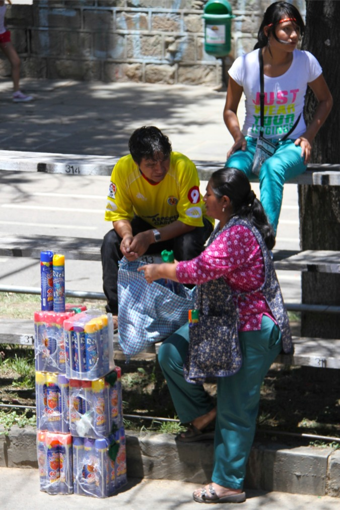Arms dealers selling spray foam, Carneval, Tarija, Bolivia