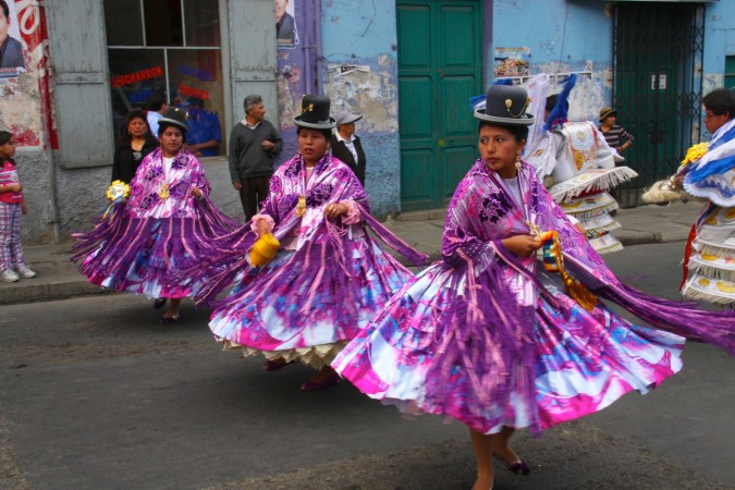 Cholitas dancing during a fiesta in La Paz, Bolivia