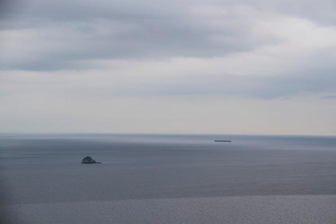 Ship arriving at the Panama Canal seen from Isla Taboga, Panama