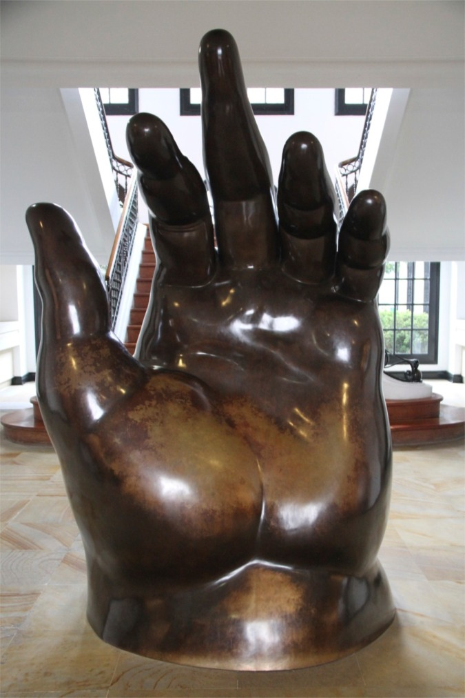 A giant hand greets you as you enter the Botero Museum, Bogota, Colombia