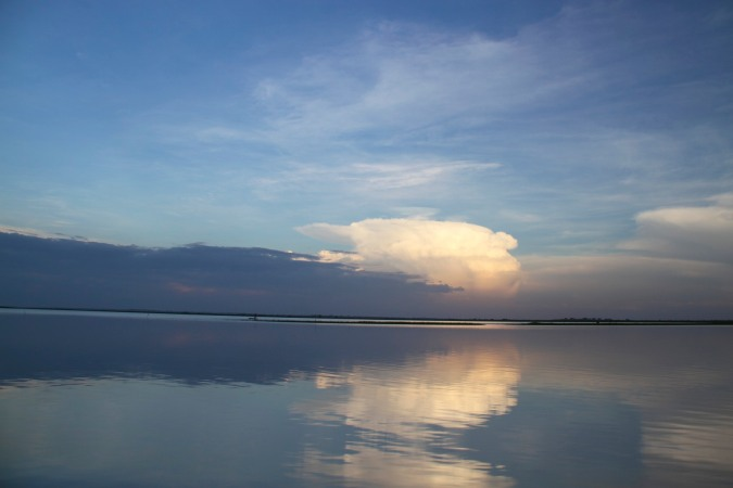 Sunset and reflections in a lake, Rio Magdalena, Colombia