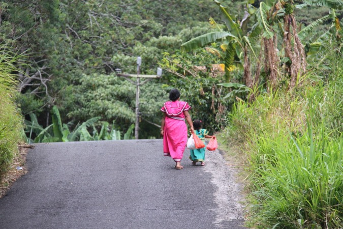 Mother and daughter walk in the countryside around Boquete, Panama
