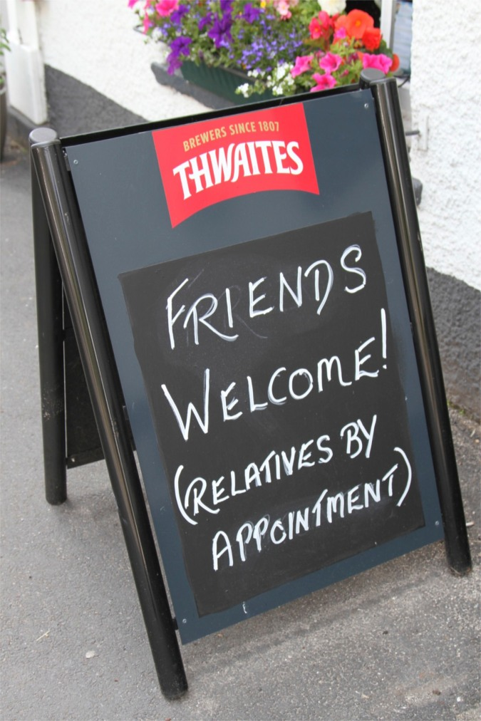 Sign outside The King's Arms pub, Burton-in-Kendal, Cumbria, England
