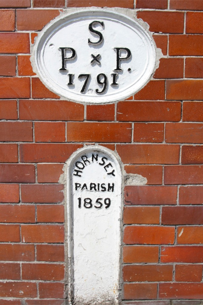 Historic signs in Highgate, London, England