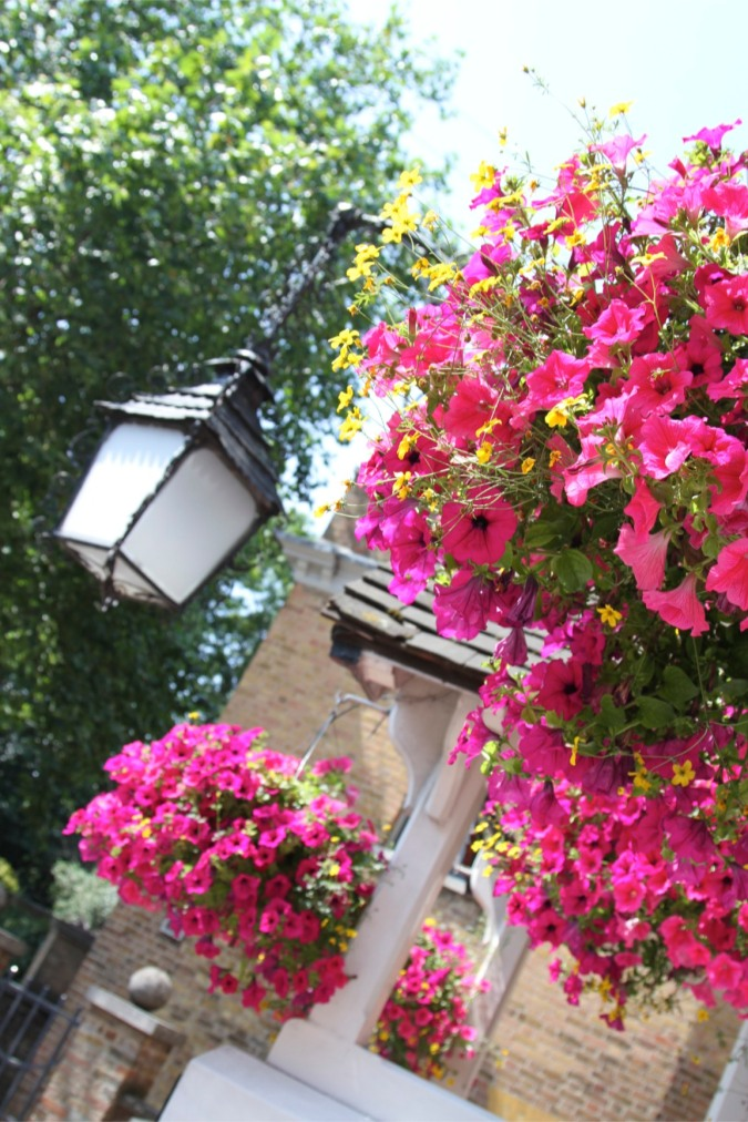 Flowers and a light outside a pub in Highgate, London, England