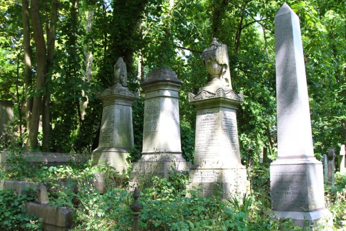 Grave of novelist 'George Eliot' (far right), Highgate Cemetery, London, England