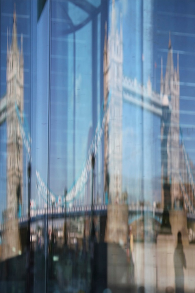 Tower Bridge reflected in London's City Hall, London, England