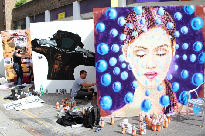 Street artists at work, Whitecross Street Party, London, England
