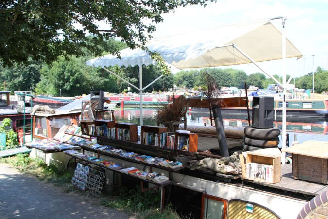 Canal boat bookshop on the Lee Navigation, Lee Valley Park, London, England