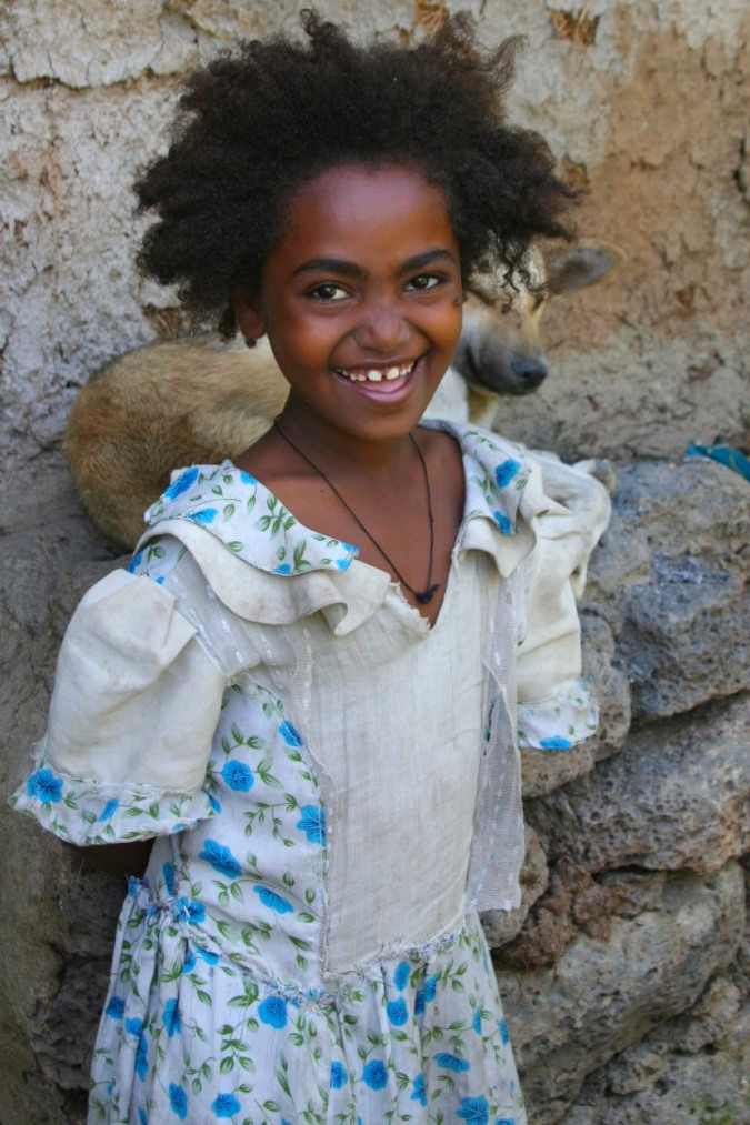 A young girl laughs, Bahir Dar, Ethiopia, Africa