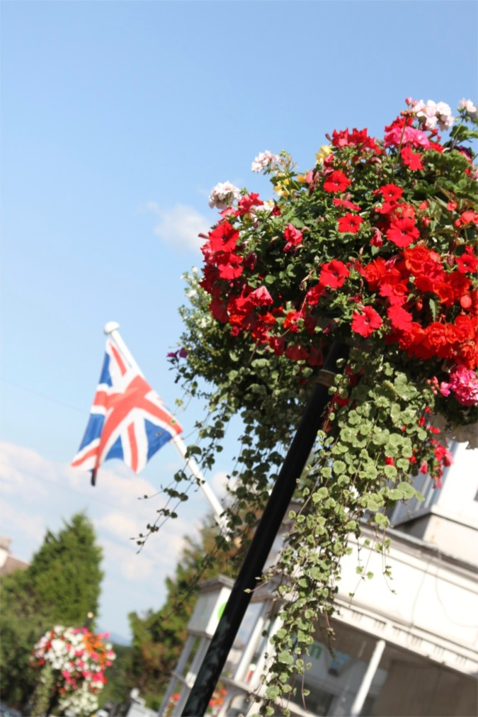 Flowers and flags. Malvern, Worcestershire, England