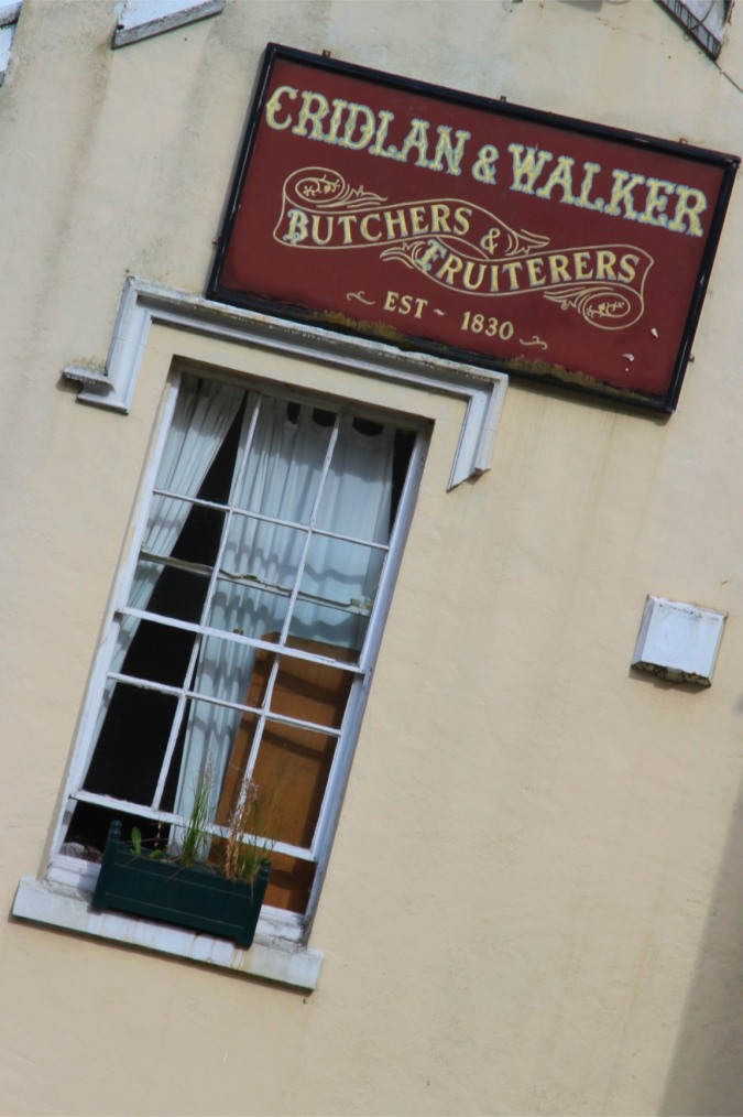 1830 sign on a building, Malvern, Worcestershire, England