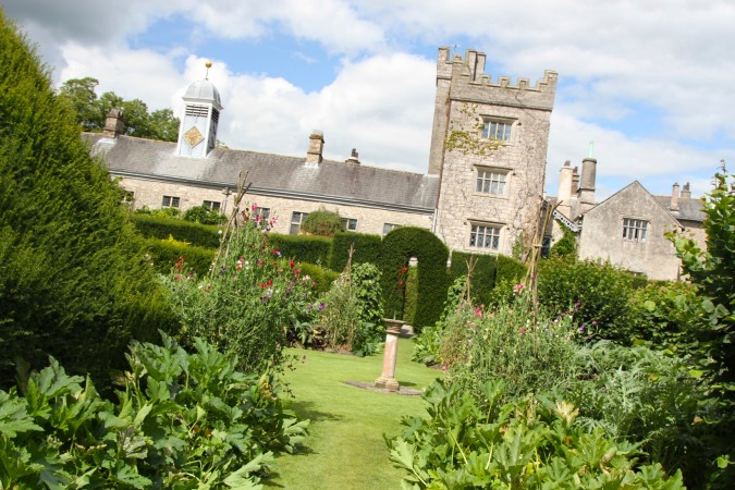 Levens Hall and sundial in the Herb Garden, Levens, Cumbria, England