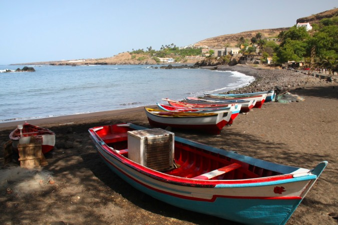 Fishing boats line the shore in the former Portuguese slave port of Cidade Velha, Cape Verde, Africa