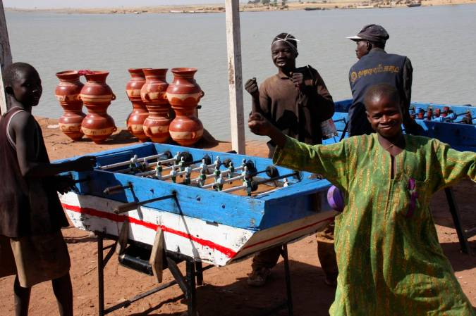 Young boys play table football, Mopti, Mali, Africa