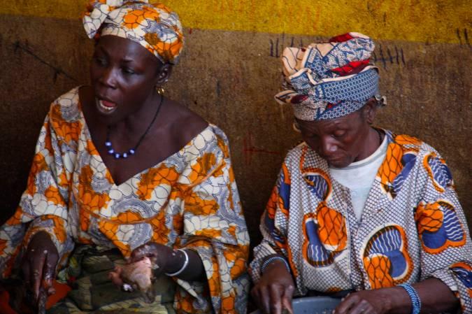 Women clean fish, central market, Mopti, Mali, Africa