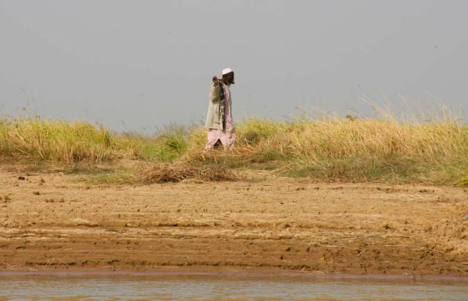 Man walks on the bank of the Niger River, Mali, Africa