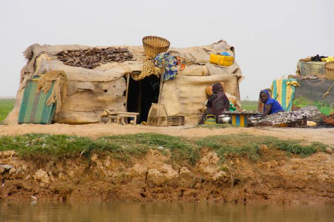 Small dwellings and people, Niger River, Mali, Africa