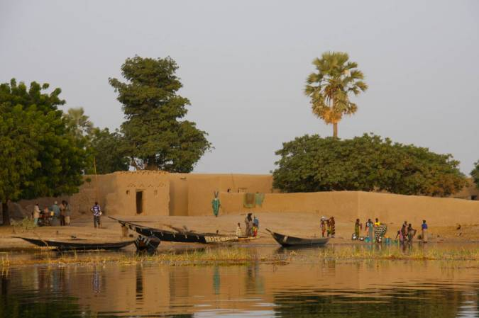 People from a village gather on the Niger River, Mali, Africa