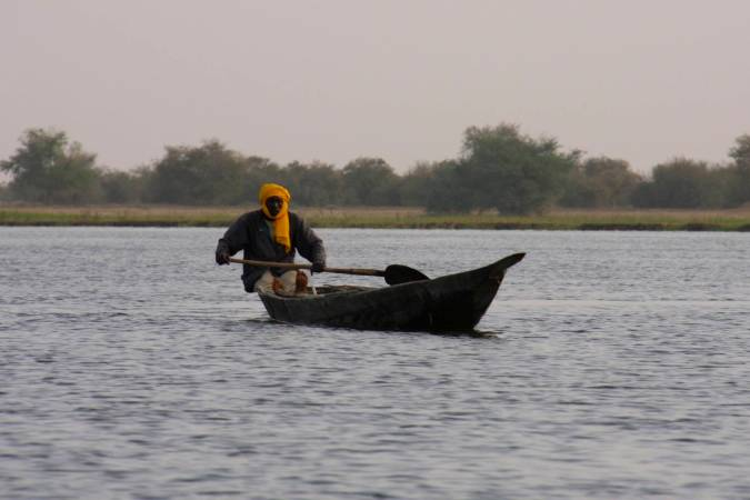 A man paddles his canoe, Niger River, Mali, Africa