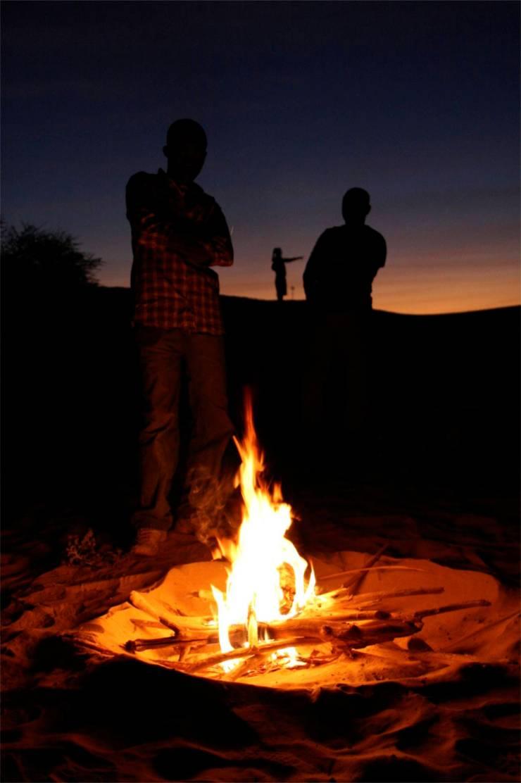 Campfire in the desert, Sahara Desert, Mali, Africa