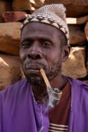 Dogon man smokes a pipe, Dogon Country, Mali, Africa