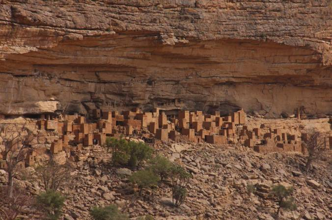 Dogon buildings under the Bandiagara Cliffs, Dogon Country, Mali, Africa