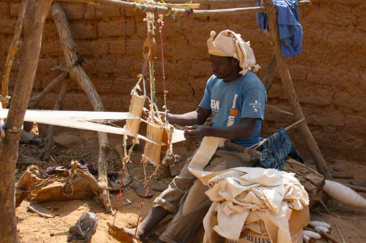 A man weaves on a hand loom, Enndé, Dogon Country, Mali, Africa