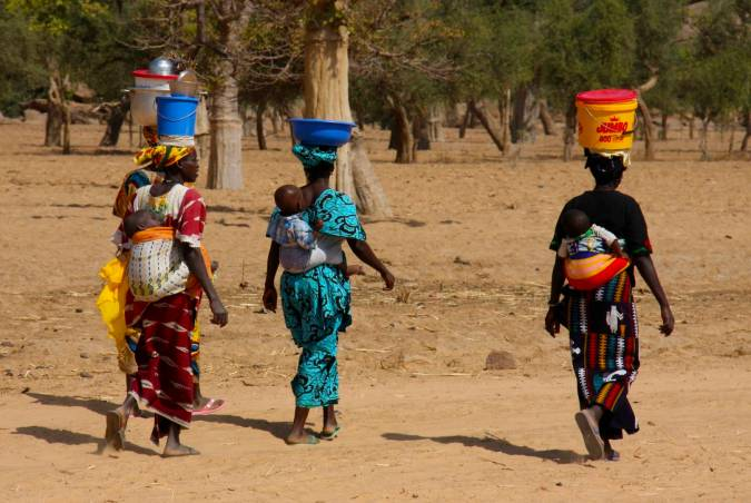 Women walking through Dogon Country, Mali, Africa